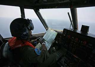 malaysian plane mystery air search expands to...