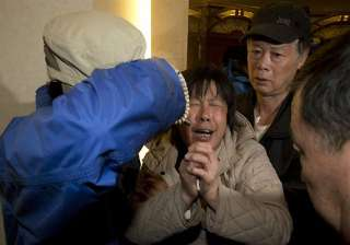 relatives sob after announcement on missing...