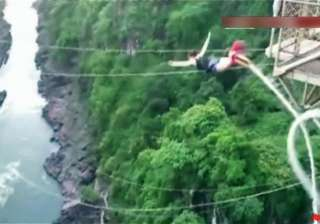 snapped bungee plunges tourist into african river...