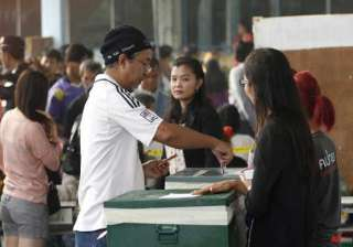 thailand holds polls smoothly in opposition...