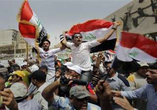 thousands rally in baghdad to protest american...
