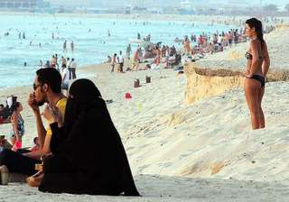 uae to enact law to ban foreigners wearing skimpy...