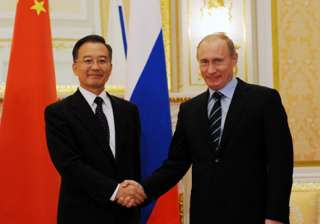 wary about us moves china russia pledge to...