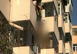 woman pulled to safety after dangling from fourth...