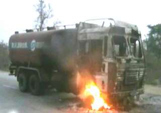 14 trucks torched after woman s death under...