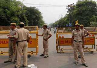 action against four delhi police officials for...