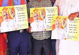 bjp poster in varanasi eulogizing modi as ya modi...