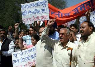 bjp activists hold protests against petrol hike -...