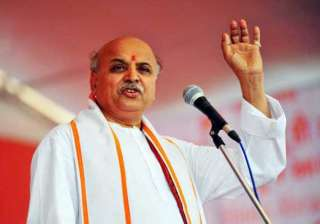 court seeks police report on togadia s alleged...