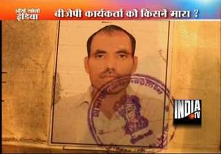 delhi bjp councillor detained after worker s...