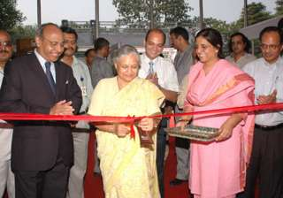 dikshit inaugurates housing complex faces protest...