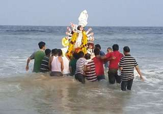 durga puja ends in bengal with immersion of idols...