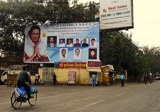 hoardings come down in agra after poll...