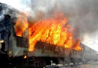 mob sets afire train compartment at delang...