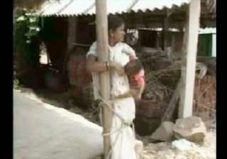 orissa villagers torture dalit woman child by...