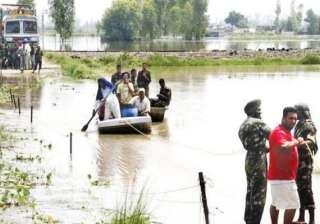 ndrf carries out rescue work in flood hit...