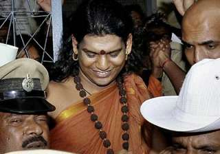 nityananda booked for mixing holy water with...