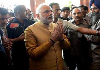 pm interacts with members after house is...