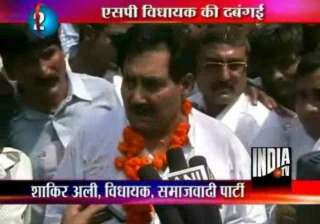 sp mla rides a horse on deoria railway platform -...