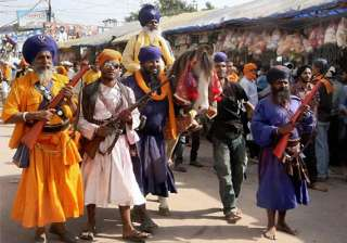 sikhs converge at anandpur sahib for hola mohalla...