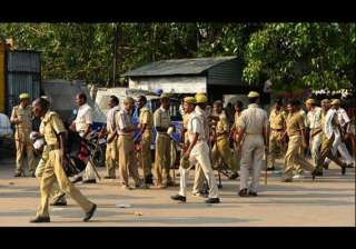 up policemen thrashed by mob for not registering...