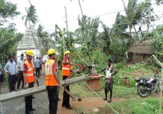 work on to restore power in cyclone hit...