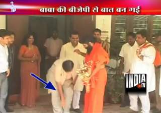 gadkari touches ramdev s feet seeks his blessings...