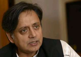 tharoor accuses modi of silence on conversion...