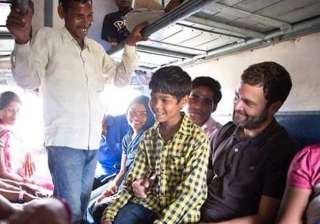 rahul gandhi travels in general coach of train to...