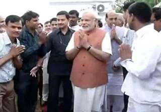modi meets party workers sunday thanks them -...
