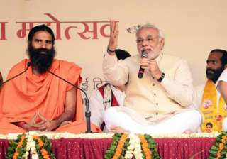 ramdev supporters root for modi at yoga guru s...
