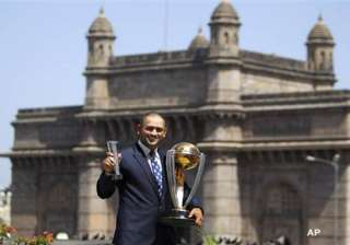 dhoni sports a bald look after wc triumph - India...