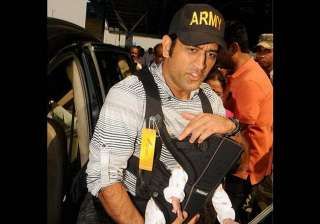 in pics india captain ms dhoni spotted with his...