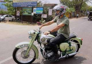 dhoni fined for faulty display of number plate on...