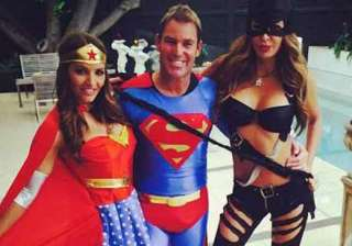 superman shane warne celebrates new year with...
