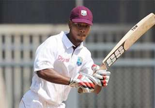 powell strikes ton as west indies a take lead -...