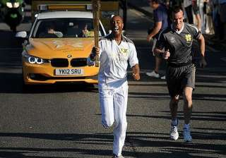 olympic torch becomes cultural happening in uk -...