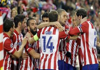 atletico beats milan 4 1 to reach champs quarters...