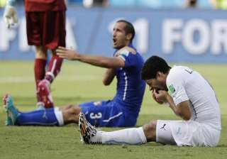 fifa world cup five controversies in luis suarez...