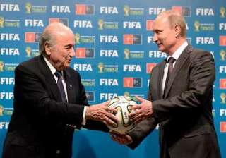 putin reassures blatter that russia can host 2018...