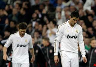 madrid follows barcelona in champions league exit...