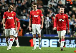 manchester united s title hopes hit by 3 0 loss...