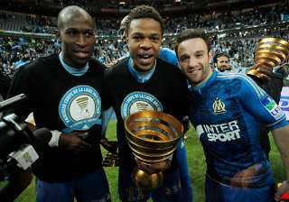 marseille lifts league cup after edging lyon -...