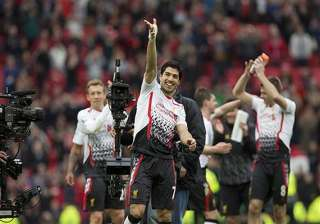 nervy liverpool stay in strong title contention...