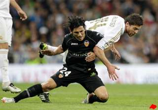 real madrid held to 0 0 draw by valencia in spain...