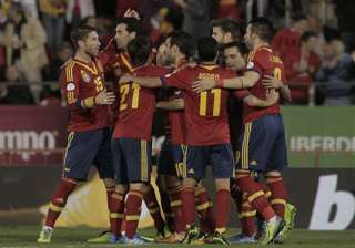 spain beats belarus 1 point away from world cup -...