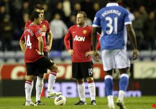 wigan inflicts shock 1 0 loss on man united -...
