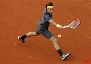 djokovic federer move on at french open - India TV