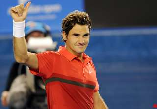 federer advances to 3rd round with walkover -...