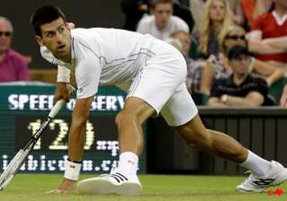 federer djokovic win at wimbledon wozniacki out -...